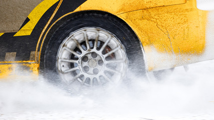 Winter rally, studded wheel of a car on a snowy road. 27.01.2018 Rostov-on-Don, Russia