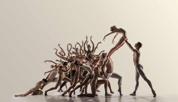 Support. Group of modern ballet dancers. Contemporary art. Young flexible athletic men and women in tights. Negative space. Concept of dance grace, inspiration, creativity. Made of shots of 11 models.