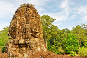 Wall Mural - Fabulous view of tower with stone faces of Bayon temple