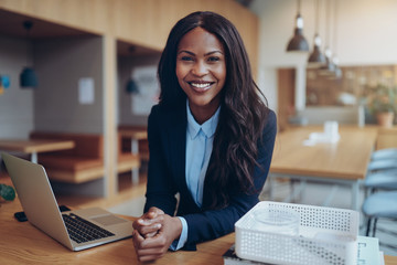 Smiling young African American businesswoman working in an offic