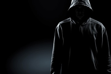 Thief in black clothes on grey background Fototapete