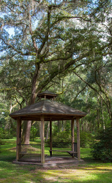 A peaceful park setting with an old gazebo.