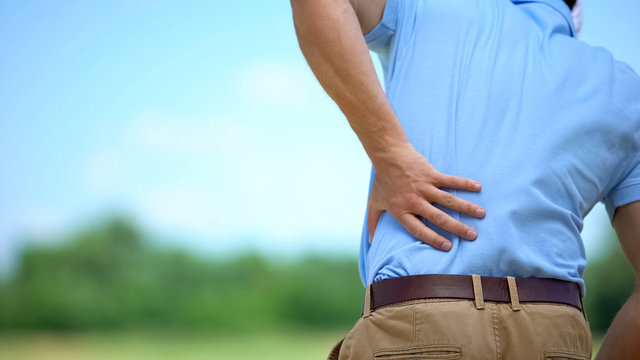Sportsman suffering terrible lower back pain, inflammation result, trauma