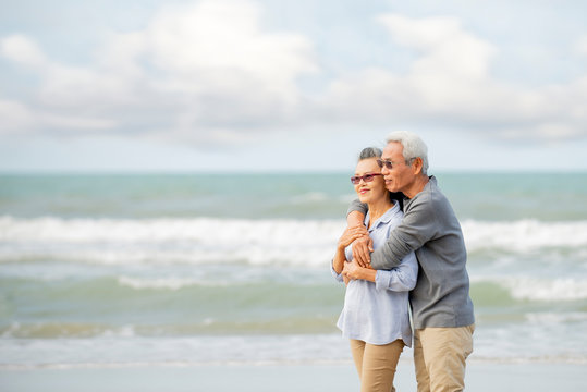 Happy asian senior couple  have fun and enjoy at the beach