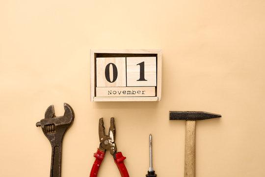 November 1st. Day 1 of November set on wooden calendar on on beige background