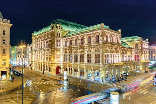 vienna state opera house in austria at night. popular tourist destination in beautiful street light. view from albertina museum balcony