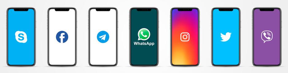 MOSCOW, RUSSIA - OCTOBER 23, 2019: Apple Iphone with different instant messenger logos: Skype, Facebook, Telegram, WhatsApp, Instagram, Twitter, Viber.