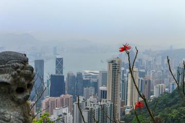 Hong Kong Skyline with Victoria Bay, Harbour and Kownloon on a foggy day with Dragon Monument. Hongkong Island Peak. Hong Kong, China