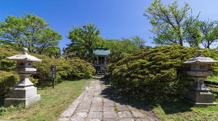 Buddhism Pagoda Monument inside Nature of Buddha Path on the Top of Mount Tsurumi. Beppu, Oita Prefecture, Japan.