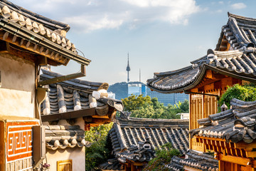 Bukchon Hanok village in Seoul with view on traditional houses roofs and tower in the distance in South Korea