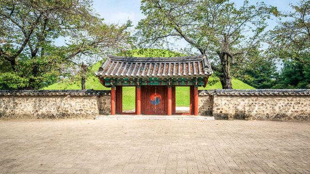 Tomb of King Michu of Silla with main gate in Daereungwon tumuli park complex Gyeongju South Korea
