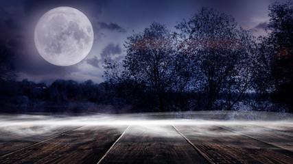 Dark forest. Gloomy dark scene with trees, big moon, moonlight. Smoke, shadow. Abstract dark, cold street background. Night view. Night wooden table Fototapete