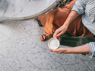 Hands of a Woman Holding Cup of Coffee