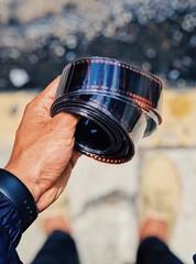 Man holding film negative roll