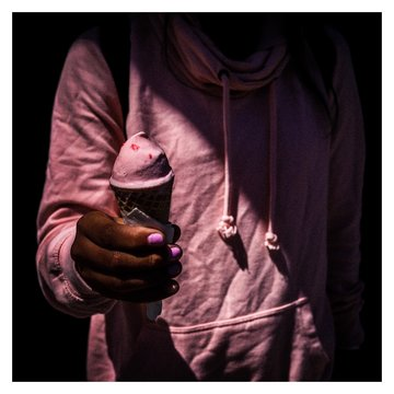 Woman holding cone ice cream