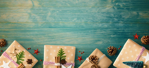 Handmade Christmas gift boxes with ornaments - flat lay