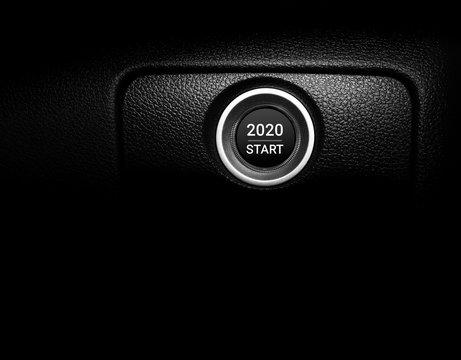 New year 2020 on car engine start button.