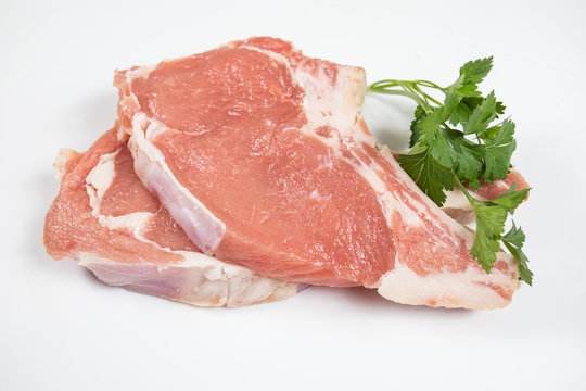 raw veal chopped on a white background
