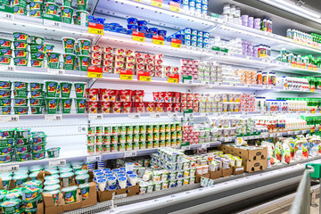 Fresh dairy products ready for sale in supermarket Auchan
