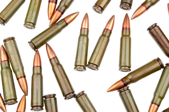 A lot of 7.62 mm cartridges for a Kalashnikov assault rifle isolated on white background