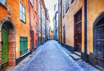 Wall Murals Stockholm Charming colorfu narrow streets of old town in Stockholm, Sweeden