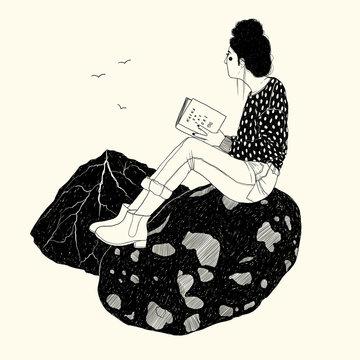 Lesende am Strand