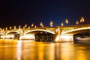 Bridge illuminated by lanterns in the evening in Budapest