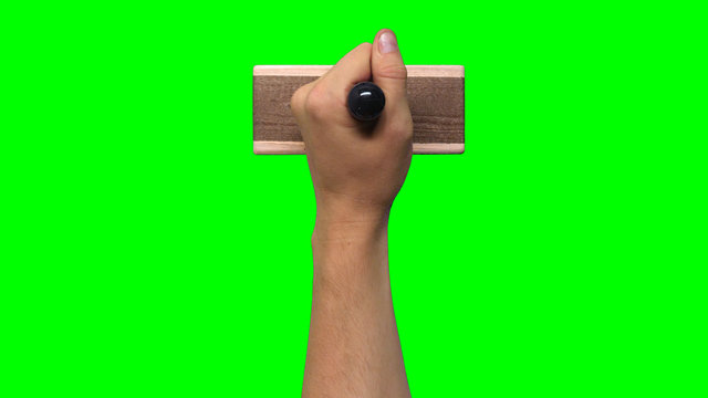 Hand Holding Large Stamp on Chroma Key Green Background