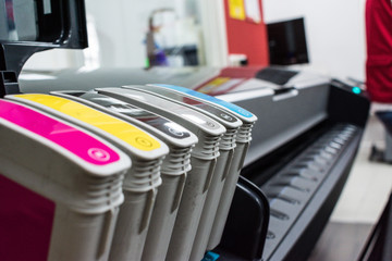 Close detail of ink cartridges in plotter for printing