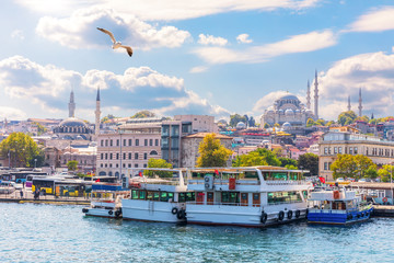 Istanbul sights view: the Eminonu pier, the Rustem Pasha Mosque and the Suleymaniye Mosque