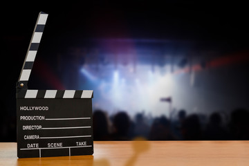 Slate film, Film clapper or Movie director slate on wood table with De-focused concert crowd. background. for production of film Concept