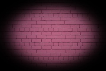 Pink brick wall with strong vignette.