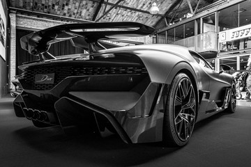 A sports car Bugatti Divo, 2018 on May 01, 2019 in Berlin, Germany. Rear view. Black and white.