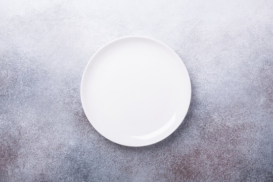 Empty white plate on stone background Copy space Top view - Image