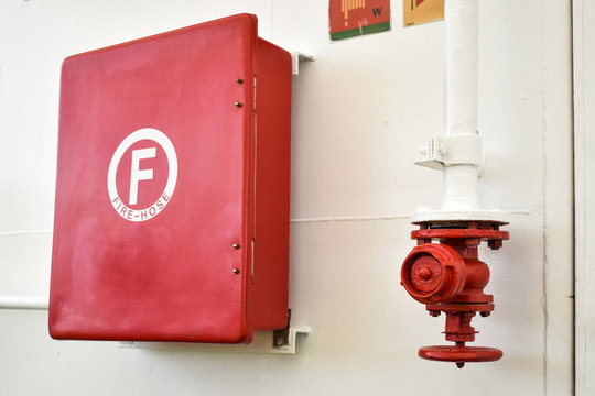 Red fire hose cabinet and fire hose connector - hydrant