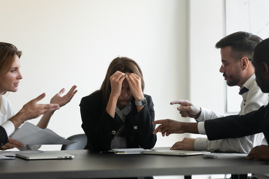 Stressed upset business woman suffer from bullying harassment at workplace