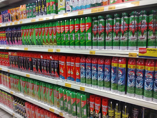 KUALA LUMPUR, MALAYSIA - MAY 11, 2019: Selective focused of insecticides in cans are displayed on shelves for sale. Separated by brand to facilitate buyers.