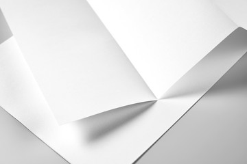 Blank Folded Letterhead or Flyer over Heap of Letterheads