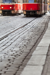 Public City Transportation on Rails / Cobblestone road at city with tram tracks and streetcar traffic detail as background (copy space)