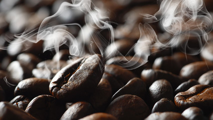 bevergae background of a roasted coffee bean on background of coffee beans with aromatic smoke