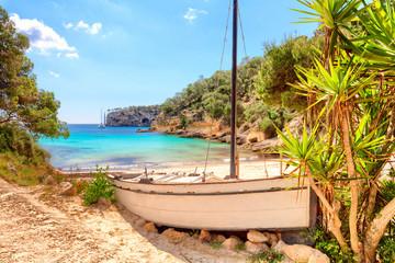 Foto auf Leinwand Schiff Cala Portals Vells Calvia Mallorca Majorca Spain old ship with palms and turquoise mediterranean sea