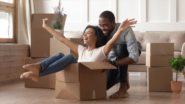 Happy black young couple have fun on moving day