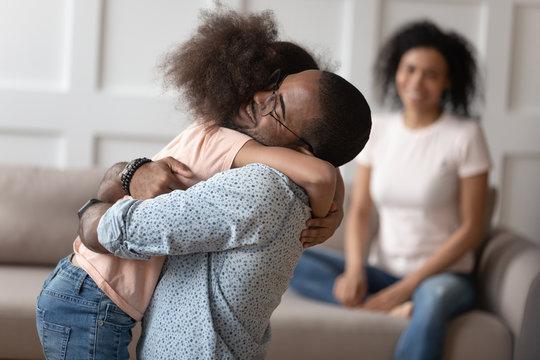 Happy little girl hug dad reunited after separation