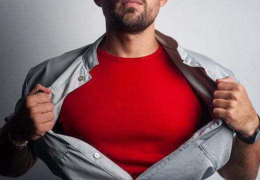 a bearded superhero tears his shirt.