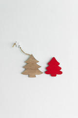 red brown wood craft Christmas tree on white cement wall background for greeting card