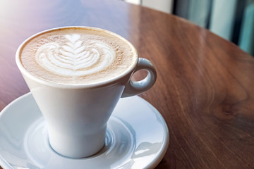 Fotobehang - Fresh cappuchino or flat white coffee in a white cup with latte art