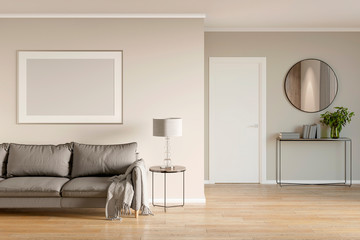 Modern living room interior with sofa, mock up poster, nightstand, lamp and door. 3d illustration