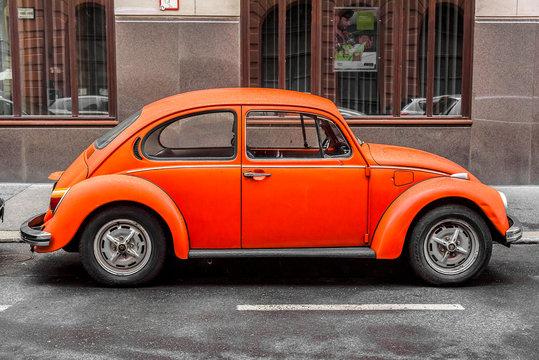 BUDAPEST, SEPTEMBER 17: Orange retro car Beetle parked on the old street on September 17, 2016 in Budapest, Hungary.