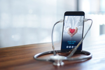 Fototapeta Stethoscope wear with smartphone, Doctor through the phone screen check health. Online medical consultation, online medical and medicine clinic connect and communication with patient, doctor online