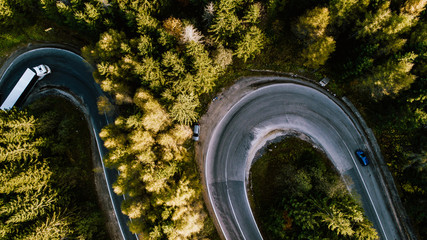 Aerial view of mountain curved road with truck heavy traffic. Asphalt serpentine roads details